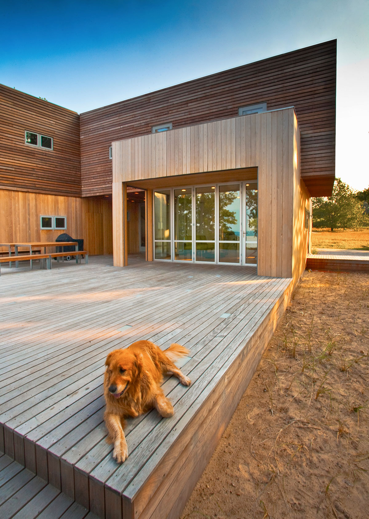 Wooden deck of the sustainable lake house project in Omena, Michigan designed by the architecture studio Danny Forster & Architecture
