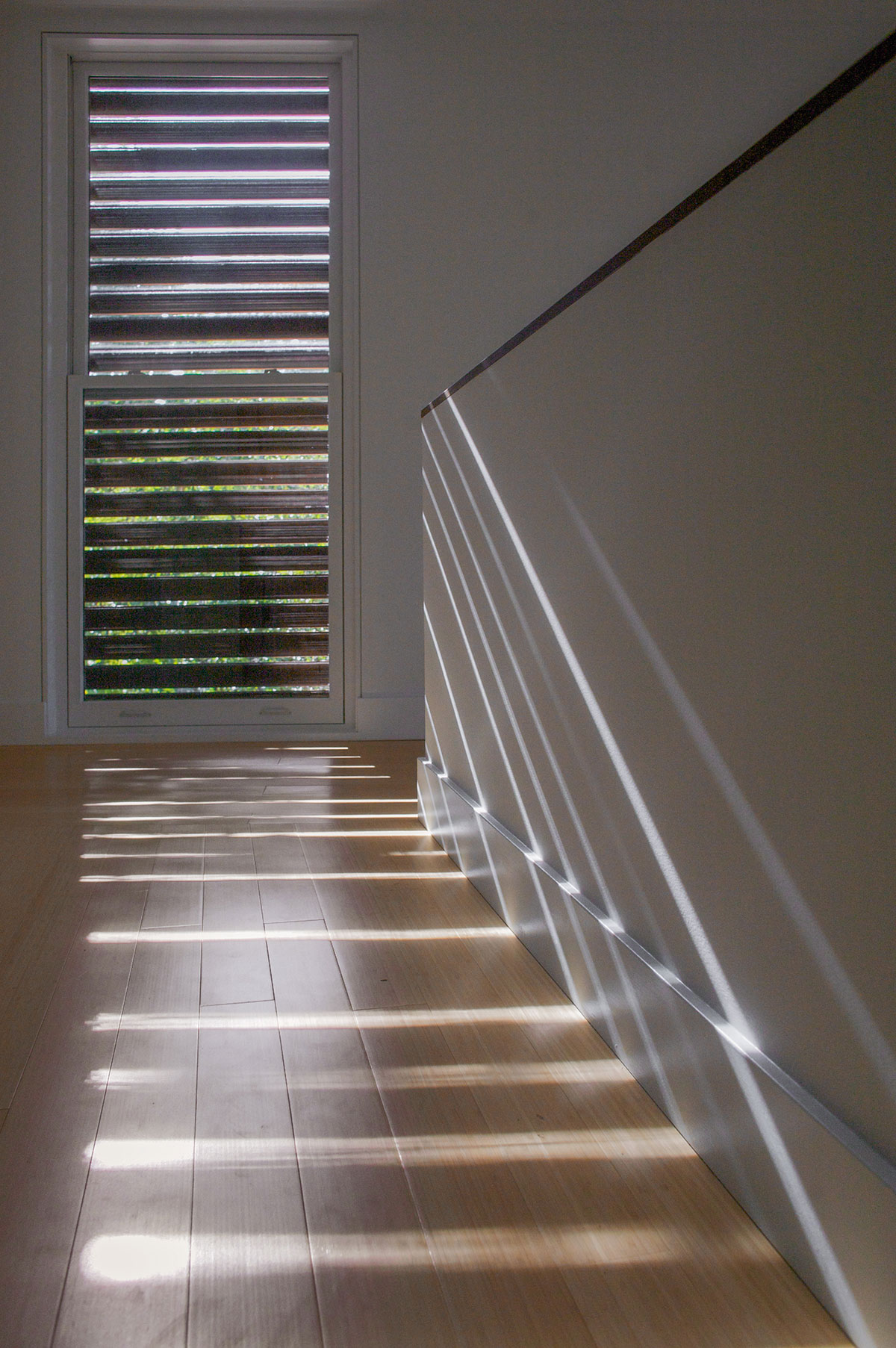 Light and shadow on the interior of the sustainable lake house project in Omena, Michigan designed by the architecture studio Danny Forster & Architecture