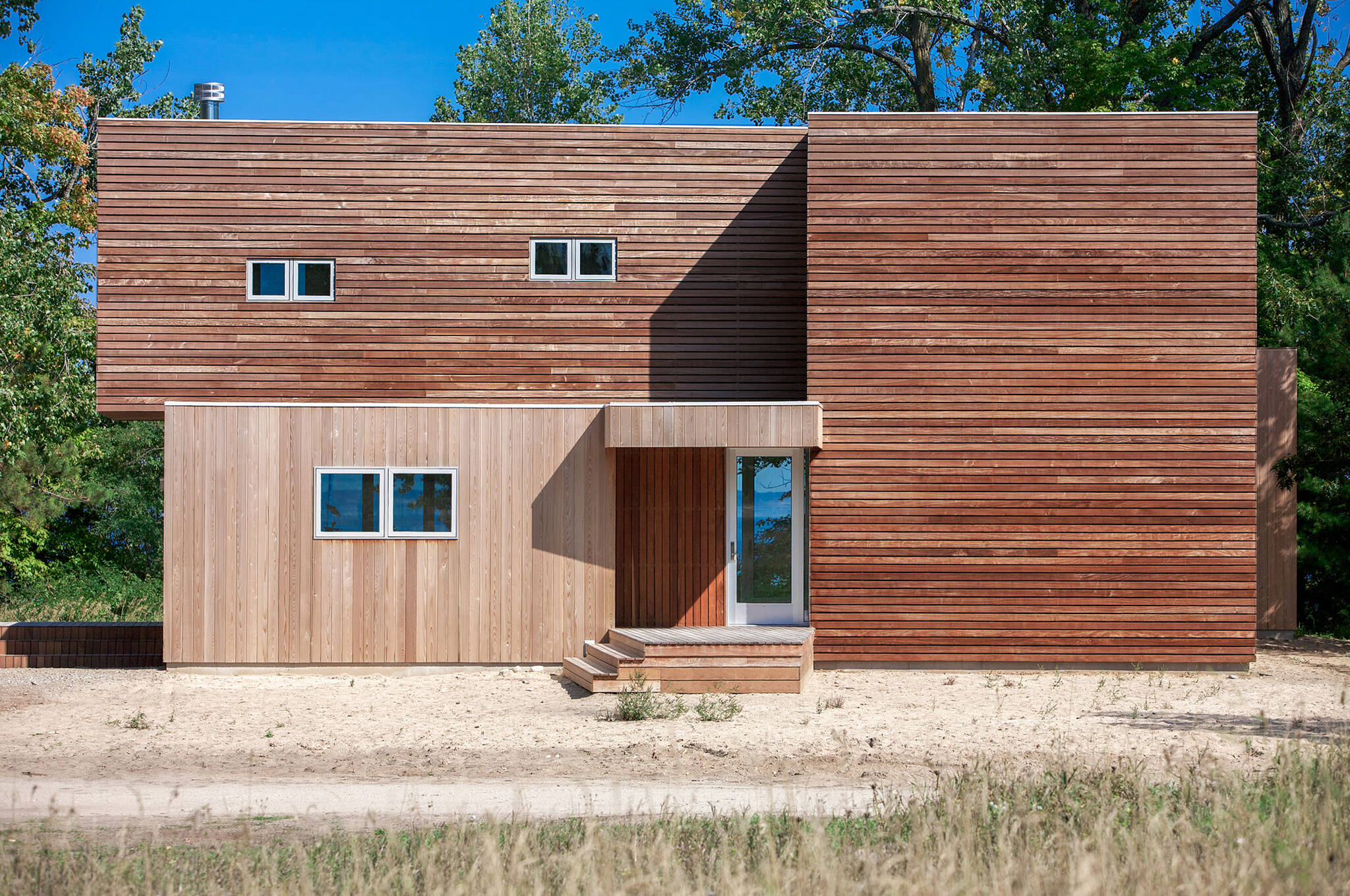 West elevation of the sustainable lake house project in Omena, Michigan designed by the architecture studio Danny Forster & Architecture