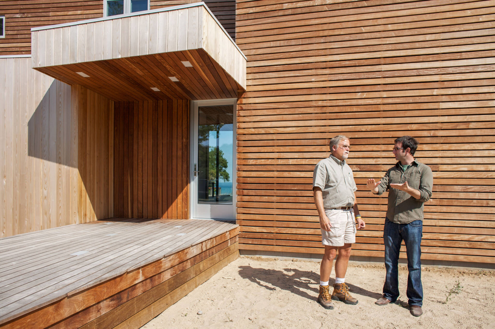 Human scale on the front door of the sustainable lake house project in Omena, Michigan designed by the architecture studio Danny Forster & Architecture