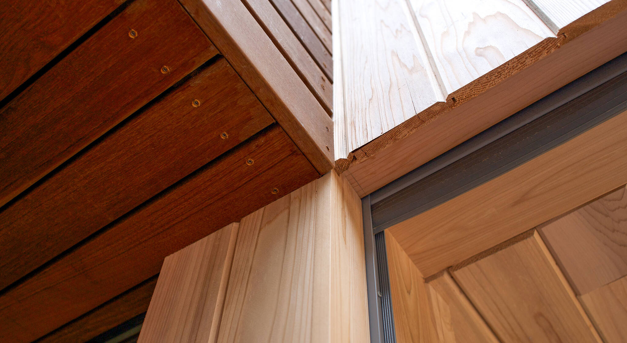 Detail of wooden ceiling and cladding edges on the sustainable lake house project in Omena, Michigan designed by the architecture studio Danny Forster & Architecture