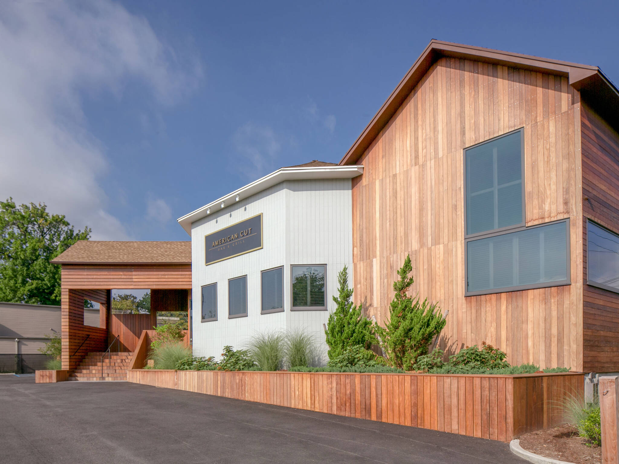 Driveway view of the American Cut Bar & Grill project located at 495 Sylvan Avenue in Englewood Cliffs, New Jersey designed by the architecture studio Danny Forster & Architecture
