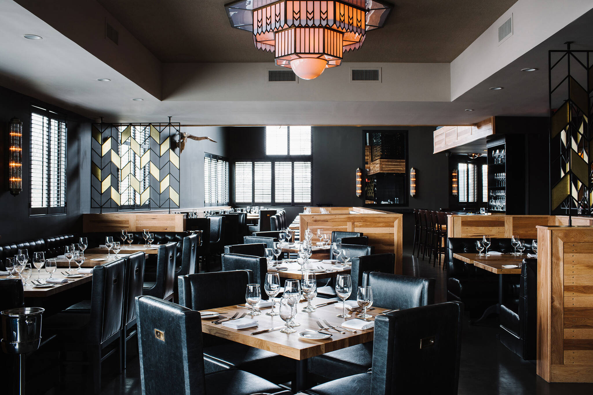 Intimate dining area of the American Cut Bar & Grill project located at 495 Sylvan Avenue in Englewood Cliffs, New Jersey designed by the architecture studio Danny Forster & Architecture