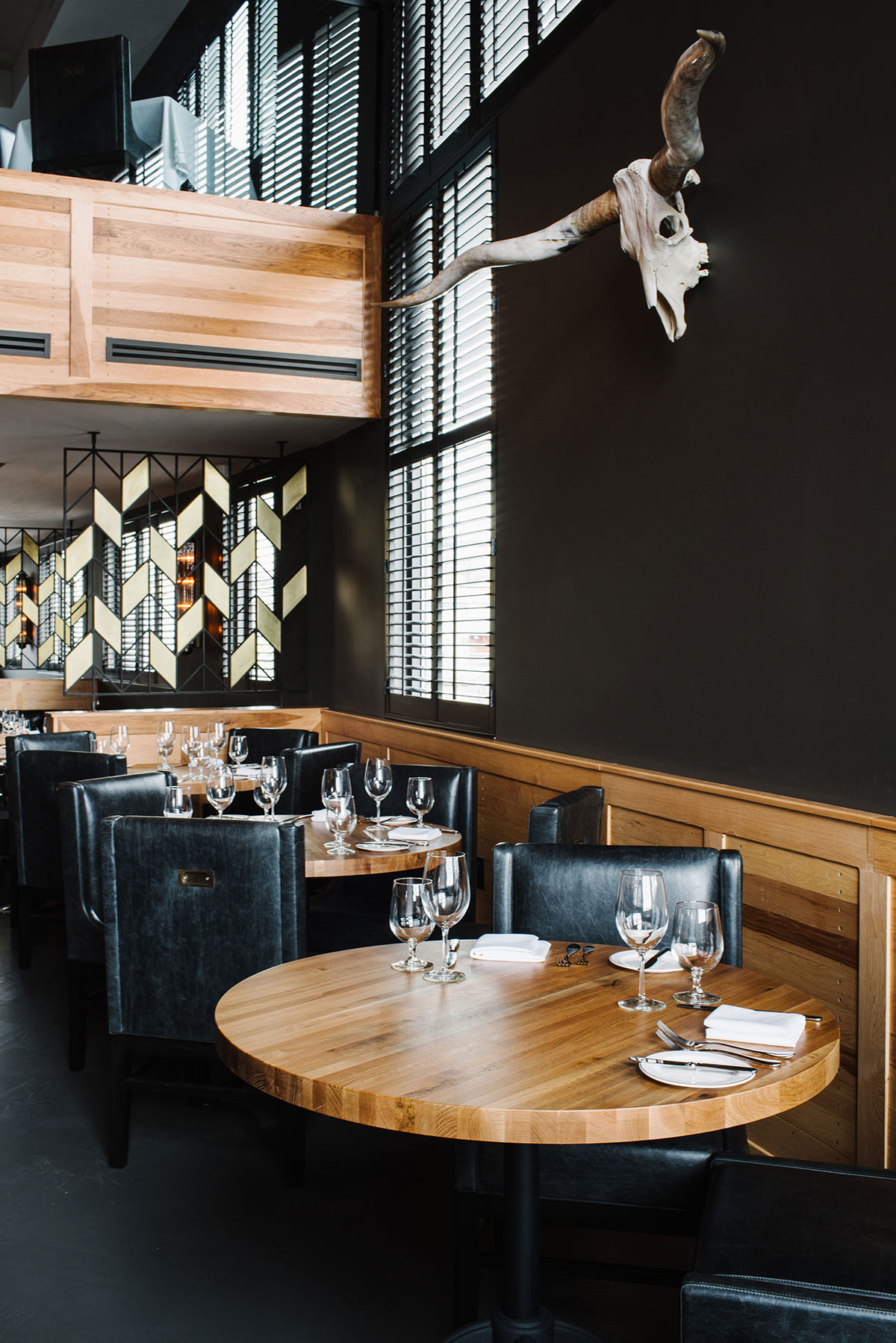 Double height dining area of the American Cut Bar & Grill project located at 495 Sylvan Avenue in Englewood Cliffs, New Jersey designed by the architecture studio Danny Forster & Architecture