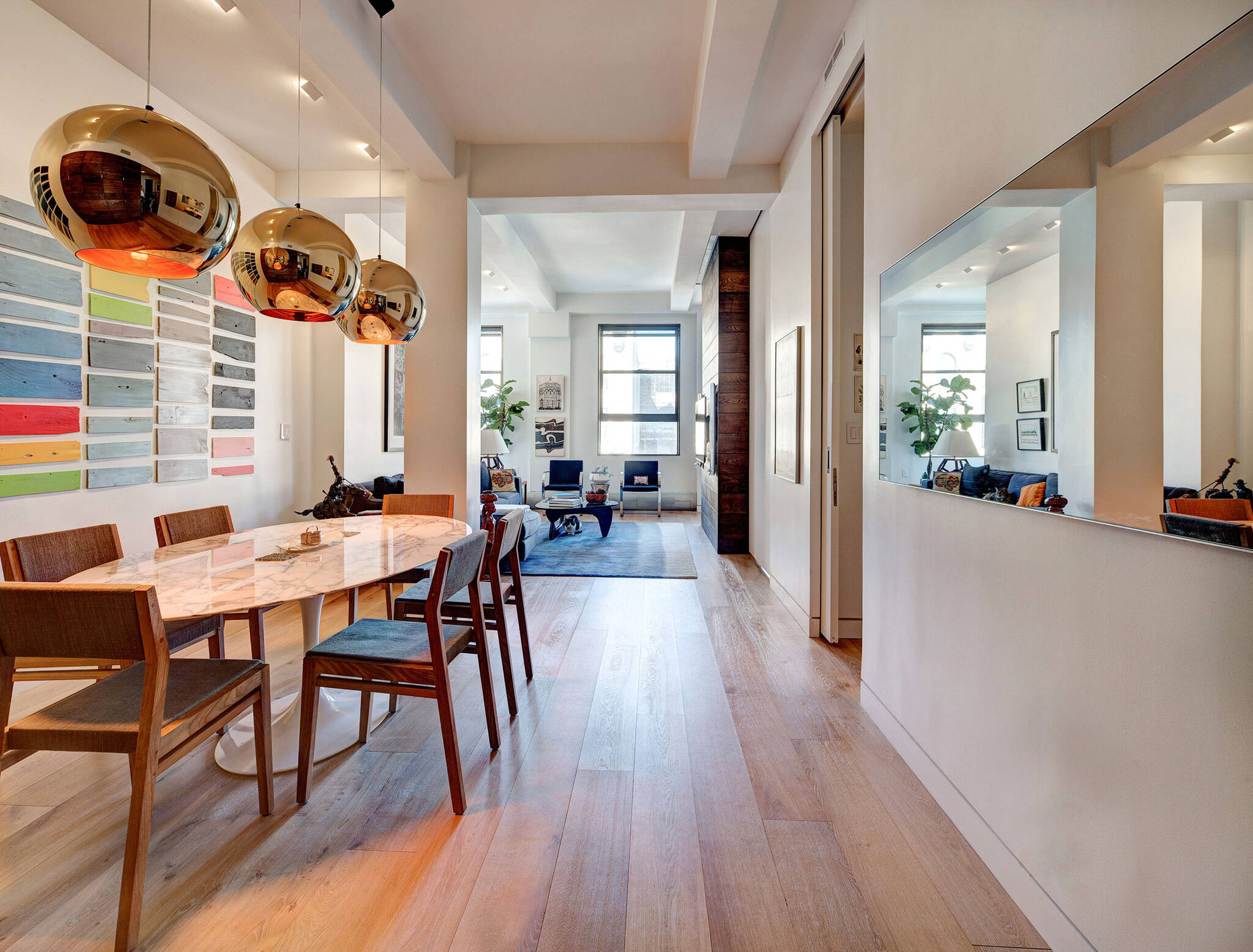 View of the dining room and living room from the entrance of the residence renovation project in the Chelsea Mews building on the Flatiron District in Manhattan, New York City designed by the architecture studio Danny Forster & Architecture