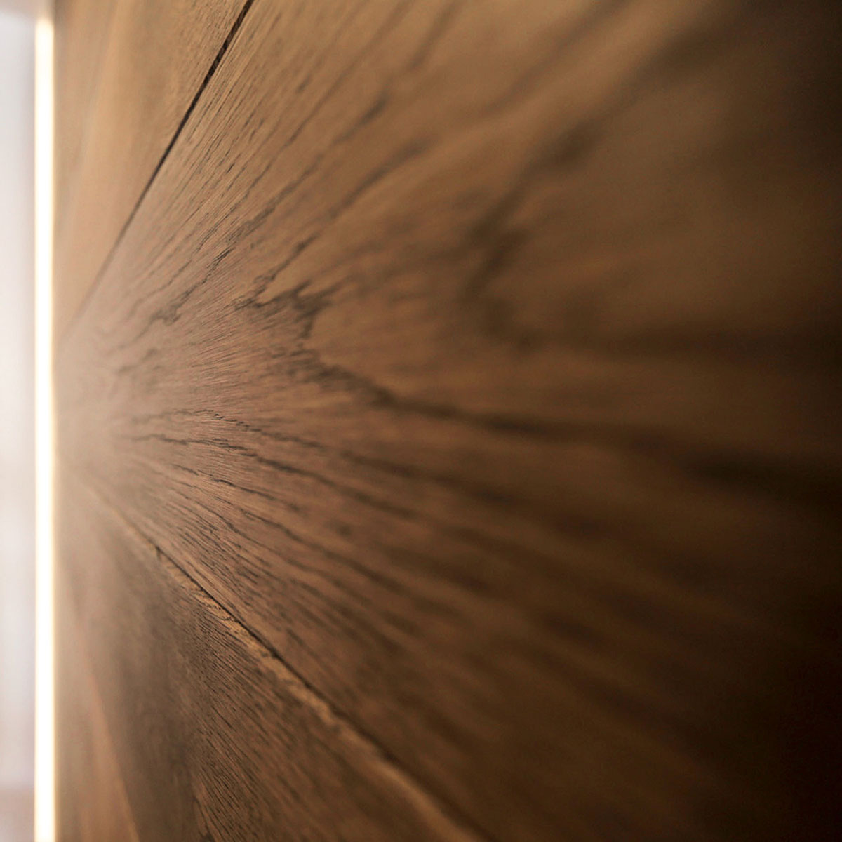 Wood grain detail of the sliding doors that divide the living room and the bedroom of the residence renovation project in the Chelsea Mews building on the Flatiron District in Manhattan, New York City designed by the architecture studio Danny Forster & Architecture