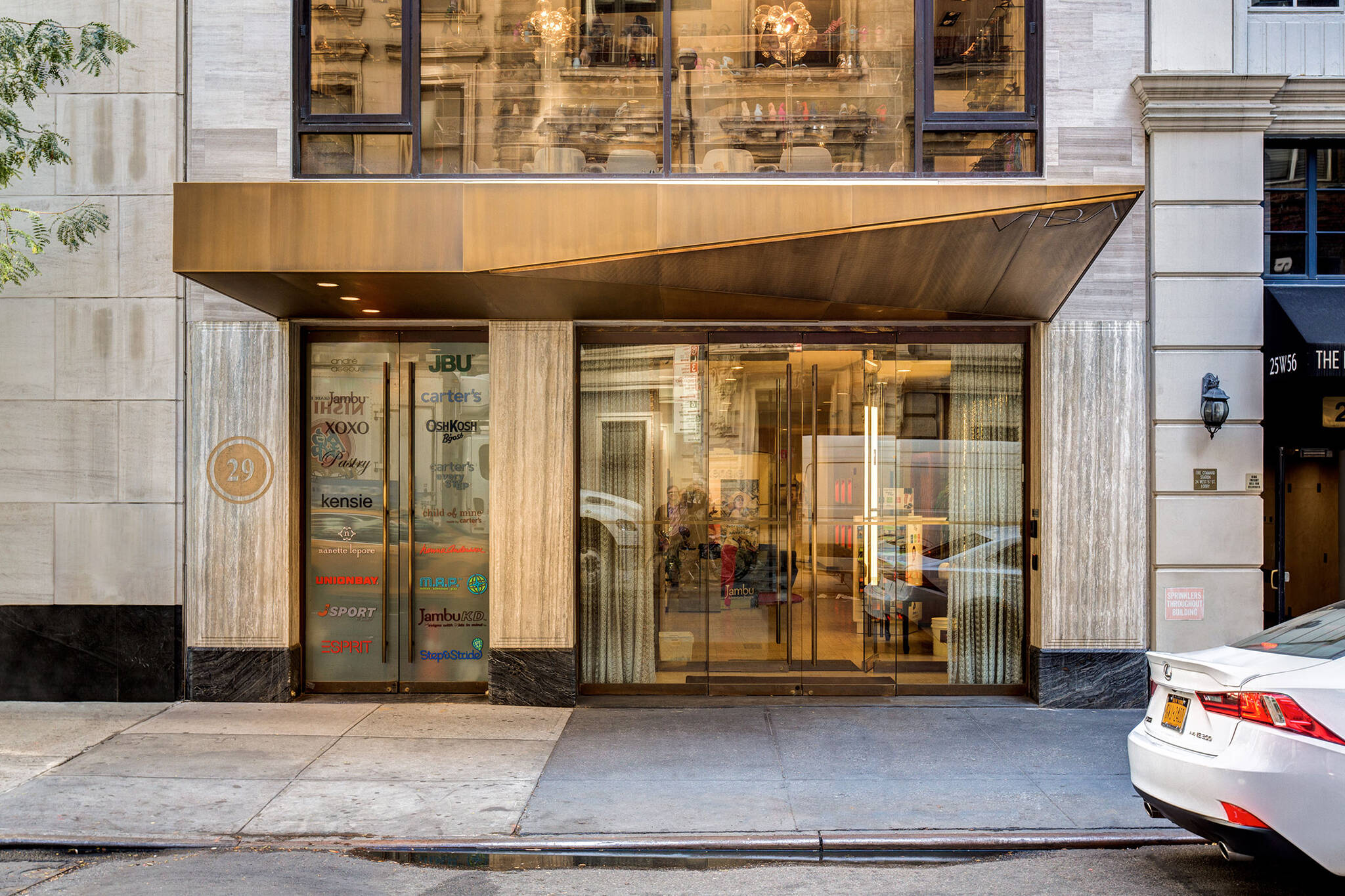 Front view of the Vida Shoes International canopy project for the shop located at 29 West 56th Street in Midtown, New York City designed by the architecture studio Danny Forster & Architecture