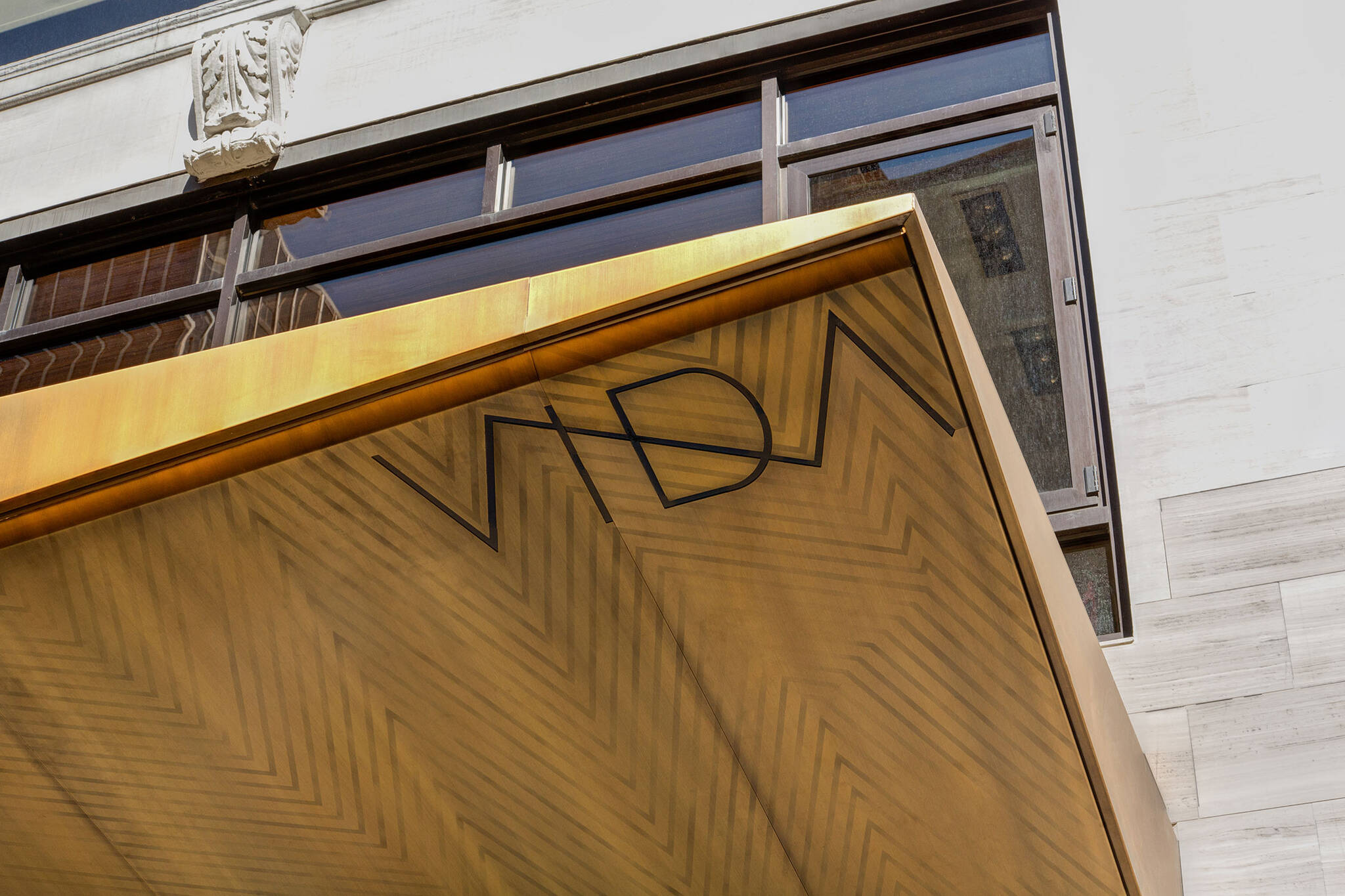 Branding on the corner of the Vida Shoes International canopy project for the shop located at 29 West 56th Street in Midtown, New York City designed by the architecture studio Danny Forster & Architecture