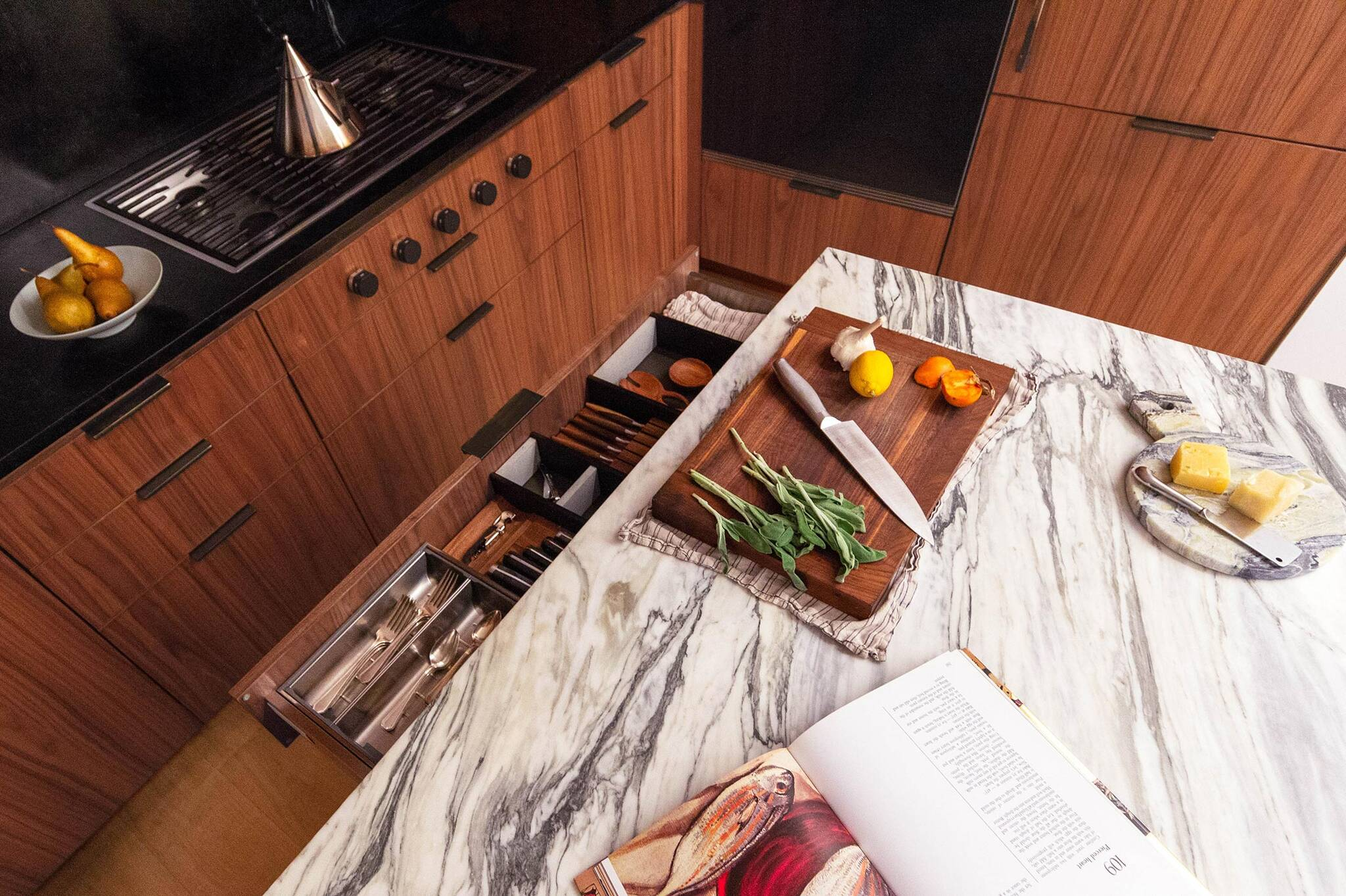 Marble island and stove top on the kitchen of the Loft renovation project in Chelsea, New York City designed by the architecture studio Danny Forster & Architecture