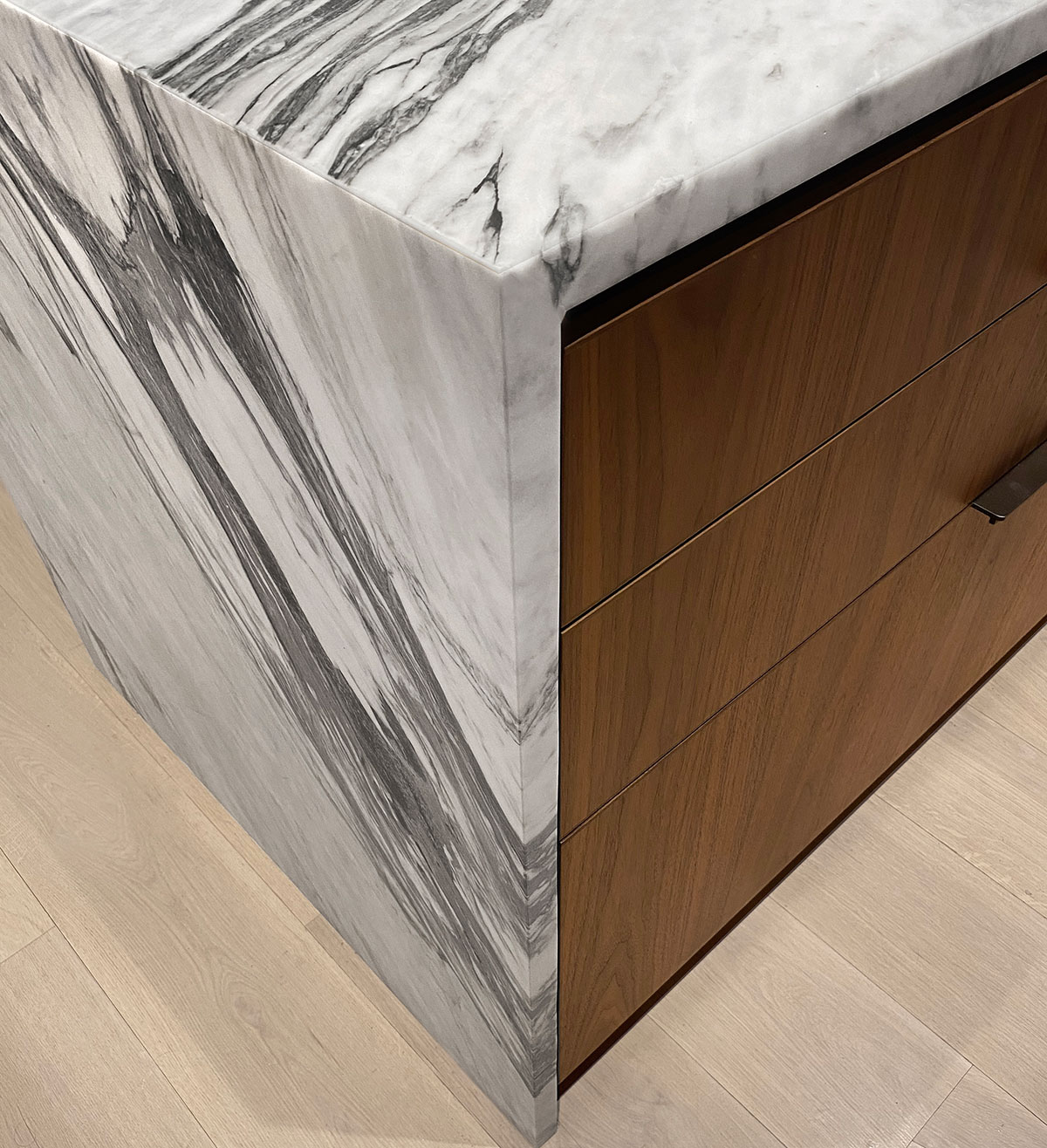 Detail of the marble island on the kitchen of the Loft renovation project in Chelsea, New York City designed by the architecture studio Danny Forster & Architecture